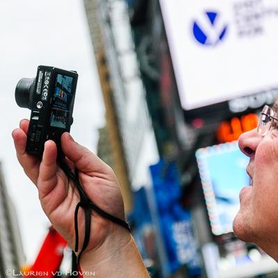 Compact fotograferen op vol Times Square